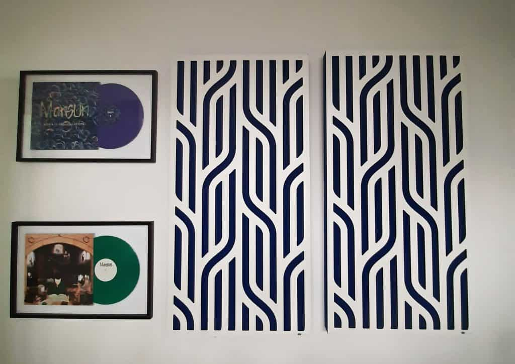 GIK Acoustic Impression Series Panels mounted on the wall next to two albums: Mansun's Attack of the Grey Lantern and SIX.